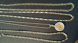 "Front to back: 29"" GT, 24"" 14k chain with $1US  gold piece and diamond bezel, 33"" 18k and 29"" 18k"