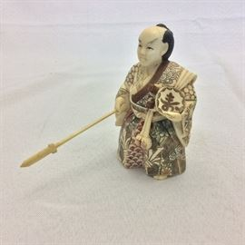 Carved Asian Figurine.