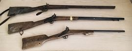 Antique rifles. Mid-1800's (19th Century). Top and middle is a Spanish rifle (brand unknown). Bottom is a replica. Top: $100. Middle: $50. Bottom: 15
