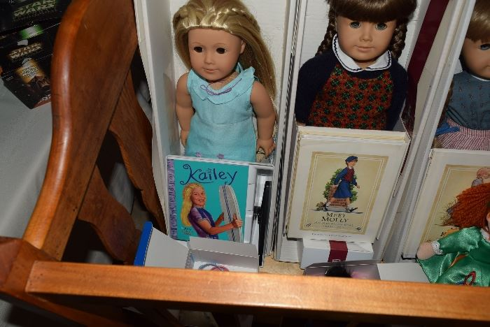 4 American Girl dolls with boxes