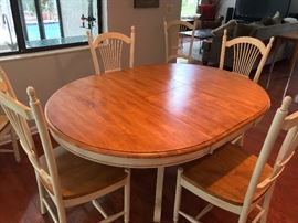 "All wood oval dining table, six chairs (65"" length)"