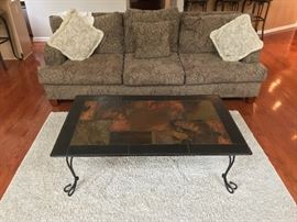 large sofa, area rug, slate coffee table