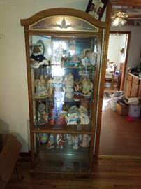 China cabinet with a collection of angels