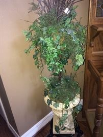 Greenery arrangement in white urn planter