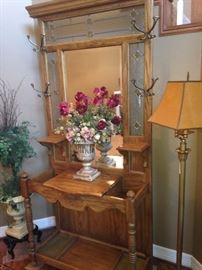Oak mirrored hall tree with hooks and places for umbrellas; floor lamp; 2 floral/greenery arrangements
