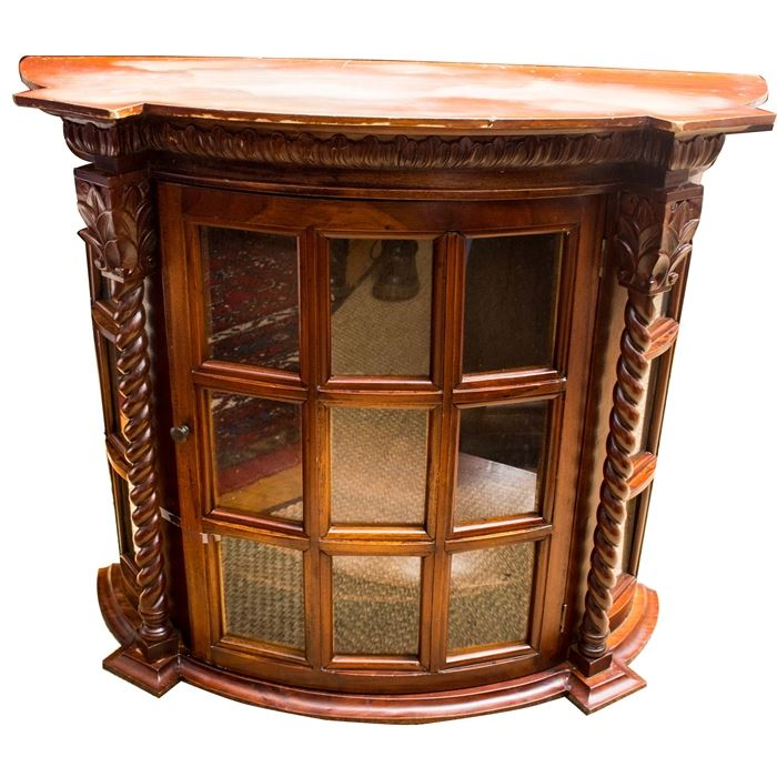 The Center Door And Side Panels Are Set With Glass Panes In A Framed Grid. The  Cabinet Has Petal Carving Along The Underside Of The Cornice, Repeated At  The ...