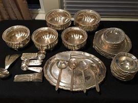 12 of the following: dinner plates, deep bowls, shallow bowls, spoons, tea spoons and forks. 12 serving pieces, two platters, three serving bowls, two large serving bowls.