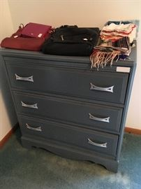 This is a nice three-drawer dresser in a nice blue hue.  Some nice purses and scarves as well.