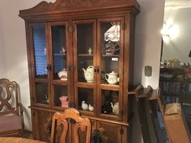 Beautiful lit china cabinet for display with lots of storage down below.