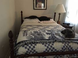 Mahogany bed frame and mattress set (cat not included).