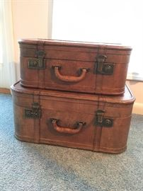 Storage containers styled as old suitcases