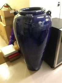 """To beautify an outdoor setting; Large cobalt blue outdoor pottery, rounded lip at opening and 4 matching decorative handles, 3' 10"""" tall"""