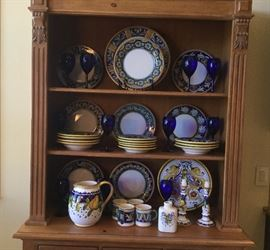 """From Durata, Italy, a complete set of 12 place settings dinnerware, dinner plates, salad plates, bowls, mugs, as well as a pair of candlesticks, large pitcher, oval platter, round platter, white ceramic bottle with painted crest on front, 6"""" H"""