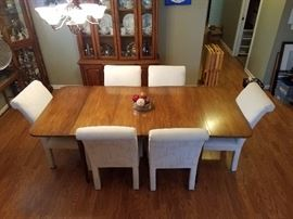 Drop Leaf Table and 6 chairs.  Max length fully expanded is 84 inches by 40 inches. Center leaf is 12 inches and there are two of them.