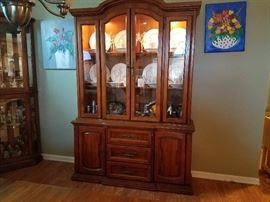 Solid Wood Lighted China Cabinet - Measures 80 inches tall, 54 inches wide and 17 inches deep.