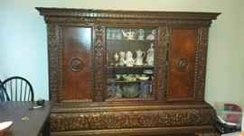 Beautiful European Hand Carved Buffet China Cabinet. Items Pictured in cabinet are not for sale.