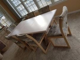 Sturdy dining set seats six; Corian top; table folds down