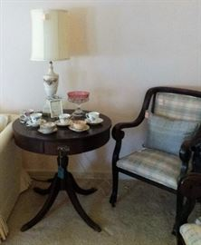 drum table, cups/saucer collection, lamp, upholstery chair