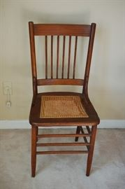 Antique cane bottom straight back chair