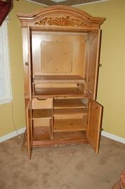 Oak entertainment center - opened to display cabinet and TV space