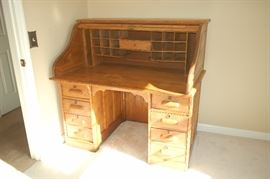 "Antique roll top desk, top open displaying ""cubby holes"" and desk top"