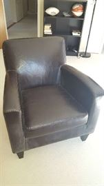Brown leather chair  $90 - as is, small fading on right inside arm