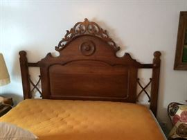 Custom queen bed made from 1800's Twin bed with ornate foot board and side rails.