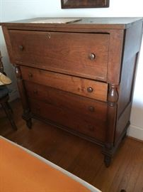 Large 4-1/2 ft. four-drawer chest c/1800. Walnut planks and original knob pulls