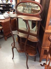 Beautiful cherry curio stand with beveled glass.
