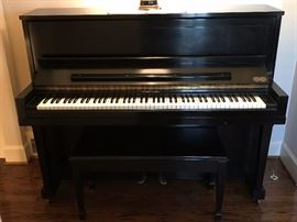 Black upright Steinway &  Sons piano