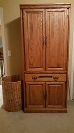 Solid wood cabinet w/shelves. Wicker hamper.