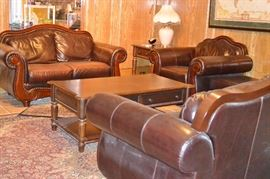 Beautiful leather living room set.  Sofa, love seat, chair and ottoman.  2 end tables, coffee table, small console table