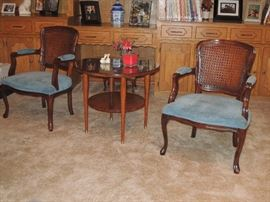vintage 50s / 60s cane back arm chairs.  Round tier 50s end table