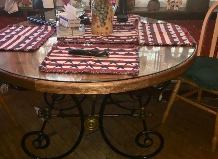 Round oak table with iron base