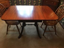 Beautiful dining room table with two inserts