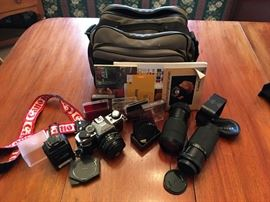 Canon camera with several lenses and equipment