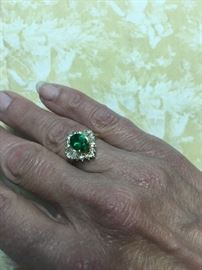 10K Gold Beautiful Emerald Ring Surrounded by CZ