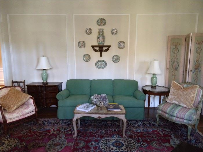 SO, here's the deal on this room.                                               The green upholstered couch is by Sherrill, the upholstered French bergere chair is unknown (recovered) Italian Florentine coffee table, vintage hand painted 4-panel screen, vintage French marble topped guéridon side table, vintage French commode, vintage exposed wood toile armchair, nice collection of Asian rose medallion plates, vintage wooden sconce, urn, from the Kuang Hsu Dynasty (1875-1908), all atop an antique 10' x 14' Lavar Kerman Persian rug, from House of Persia; original cost was $14,500.                                                                                      I have the receipt.                                                                            Don't hate!