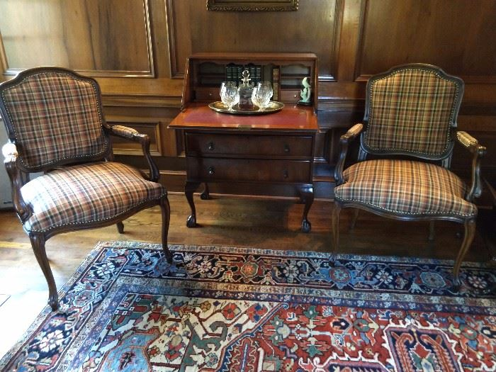 Very handsome pair of French bergere armchairs, with an antique English mahogany drop-front writing desk.