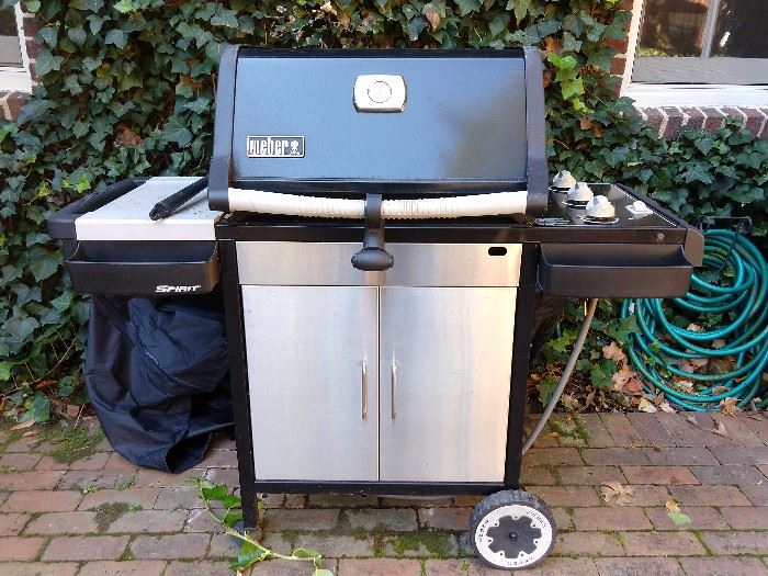 Nice Weber gas grill, with cover included.
