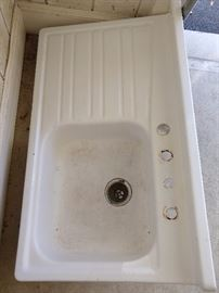 Fun! A vintage enamel sink, with built-in drainboard - great for a mountain house or potting shed.