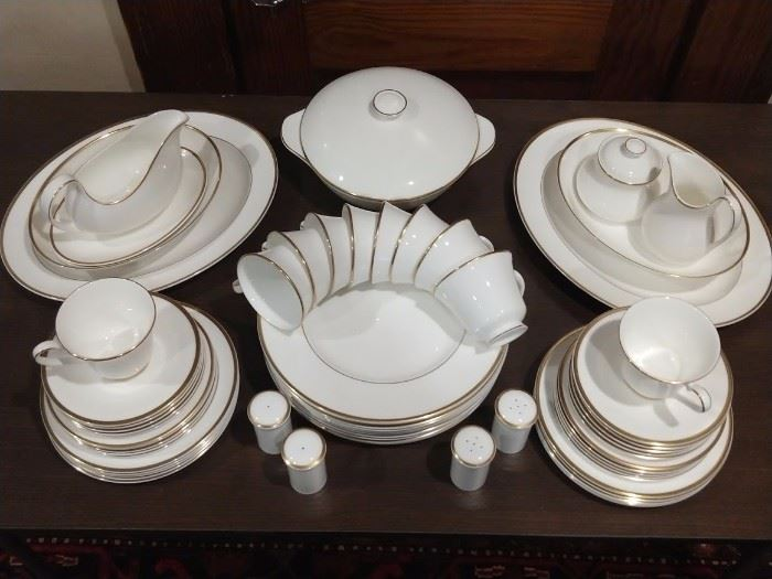 "Simple & Elegant, two of my favorite things in life!       This 64-piece set of Royal Doulton (England) ""Alice"" china is a set of 10, including serving pieces:                      -10 dinner plates                                                                                   -10 dessert plates                                                                                -10 bread plates                                                                                   -10 saucers                                                                                              -10 coffee cups                                                                                         -2 large serving platters + gravy boat/underplate                                                                    -2 vegetable bowls + 2 pair salt/peppers                                                                                 -1 lidded casserole dish + cream/sugar"