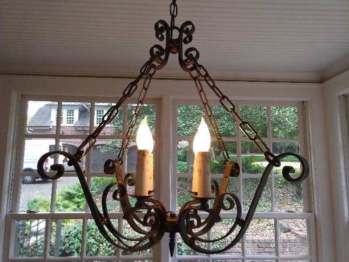 "Ooooh , yummy! A vintage, wrought iron chandelier. Don't go yankin' on all the lighting in this house, we have professional ""hep"" to remove these beauties, so they can light up your dim world."