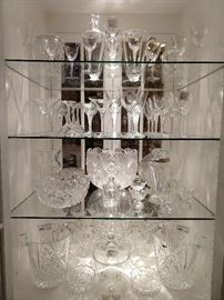 "A deep collection of  Lalique ""Phalsbourg"" stems. This is part of a large set of ""Phalsbourg"" stemware, (red & white wines, champagne coupés & cordials) + a matching decanter and pitcher. You're also looking at American Brilliant Cut Glass bowls and punch bowl, Waterford, Gorham and Czech crystal items.                                                    I know, I know, you're a crow and LOVE sparkly things, like me!"