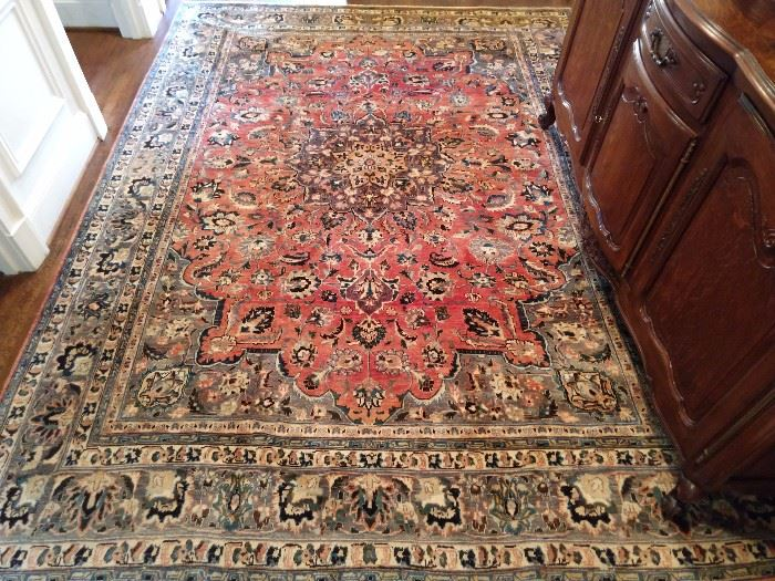 "Vintage Persian Kashan, signed by the weaver, with muted colors, hand woven, 100% wool pile, measures 8' 4"" x 11' 7""."