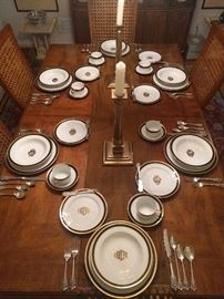 "A beautiful table, set with Christian Dior ""Monogram Black"" a pattern that's been discontinued for 30 years. There is a place setting for 8 (5 pieces per setting). The set has never been used. There are no utensil marks, nicks, chips, etc. The owner bought the set for her Mother, who thought it ""Looks like something the President would have at the White House"", so Mom never used the set. I have all the original plastic sleeves that each piece was packed with."