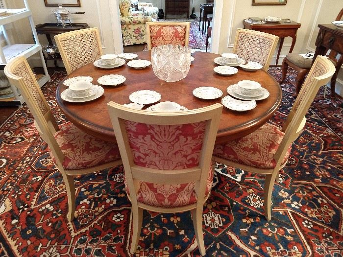 "Set of 6 French Louis XVI dining room chairs, 4 sides &  2 arms, round Drexel inlaid wood dining table, atop the huge Persian Bahktiari rug.                                                          The table is set with four place settings of the Herend ""Coronation"" china."