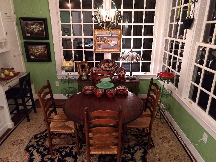 Breakfast room, all dolled up, with original oil paintings, hand woven Persian design rug, vintage Mexican pottery, Tiffany style stained glass table lamps, vintage wire tater bins and more!