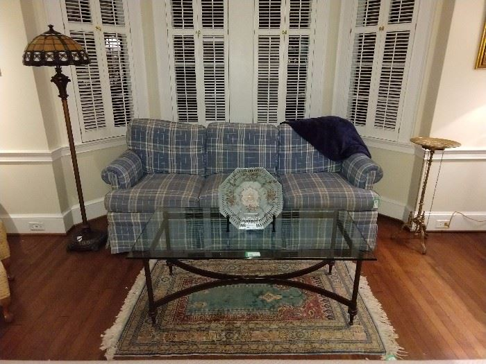 Not too offensive plaid sofa, by Hickory Chair, with nice wrought iron/beveled glass coffee table and complimentary color hand woven Persian rug.                          Just snuggle next to your honey bunny on this thing and have sexy kwaffee tawk!