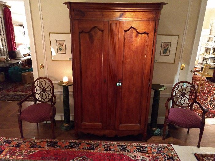 "The antique French armoire measures 7' 7"" T x 2' D x 4' 2"" W."